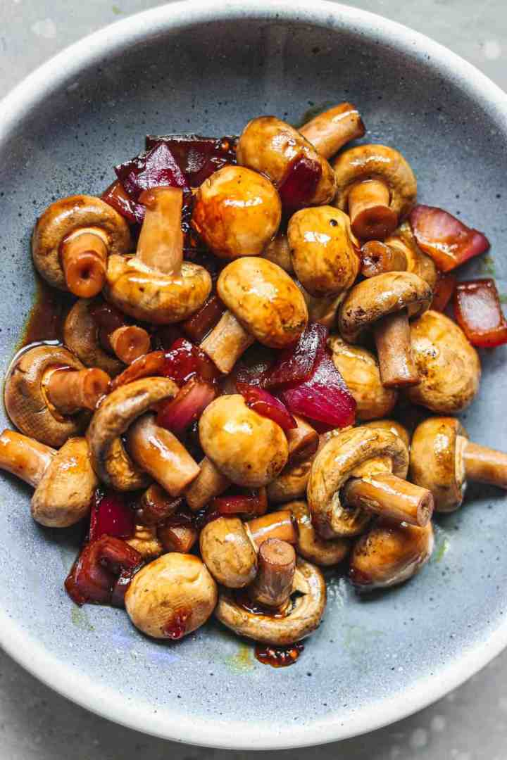Mushrooms in a blue bowl with a miso glaze