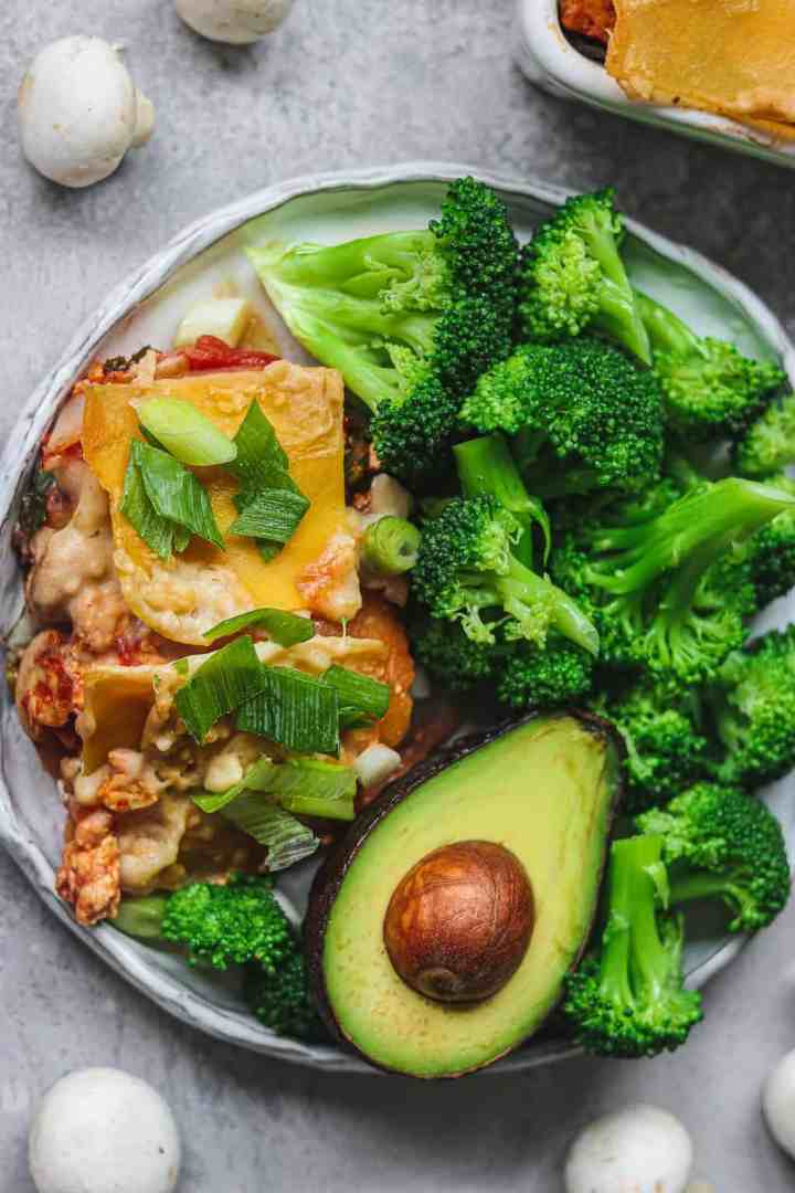 White plate with lasagna and broccoli