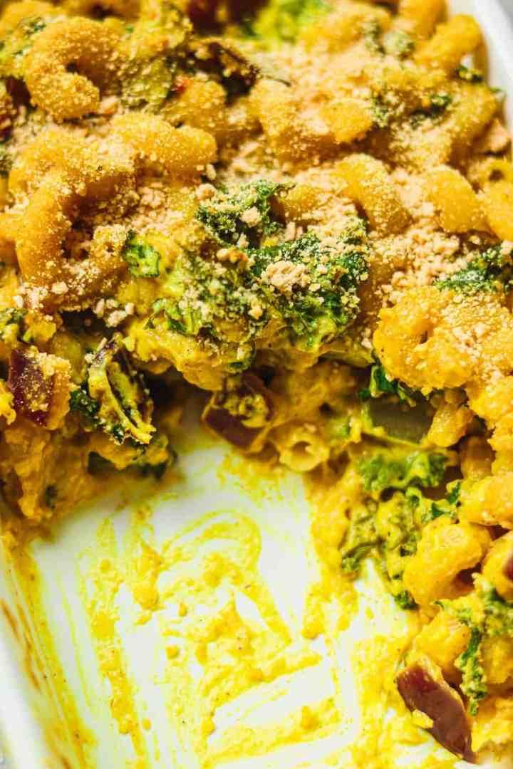 Closeup of vegan cheesy pasta in a baking dish