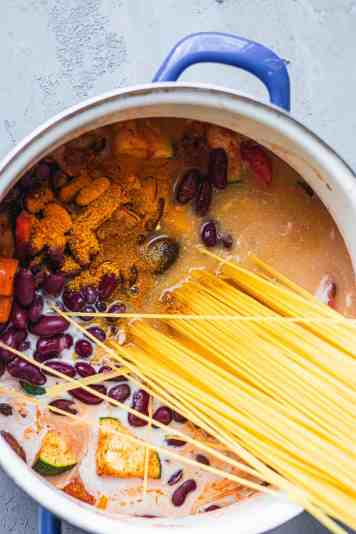 Spaghetti in a saucepan with kidney beans
