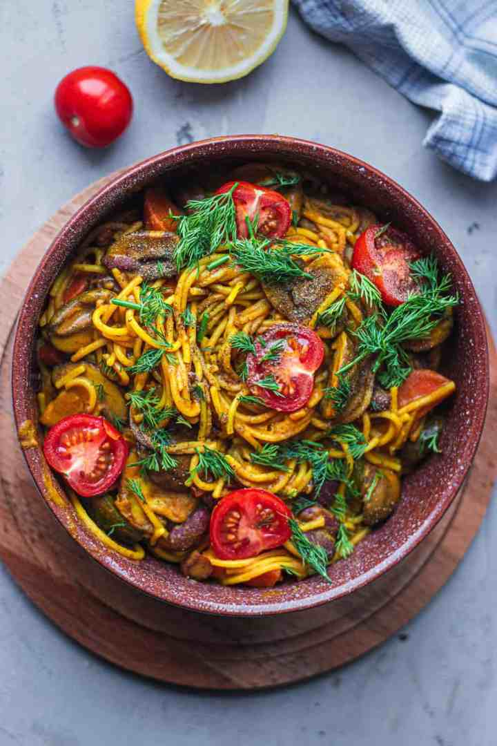 Vegan spaghetti with vegetables mushrooms and beans