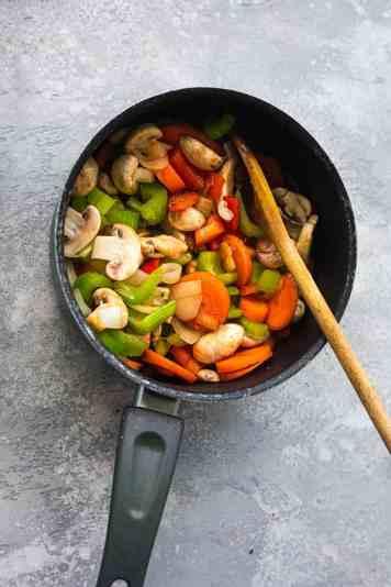 Mushrooms and vegetables in a saucepan