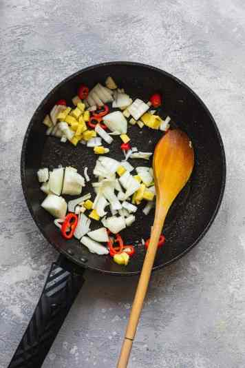 Onions, garlic, ginger and chillies in a frying pan