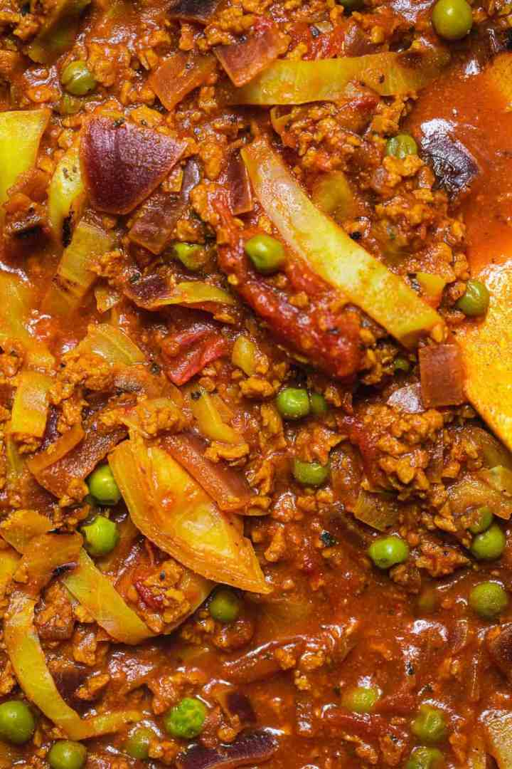 Closeup of stew with peas and soy mince