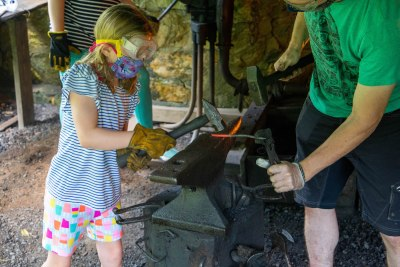 Young girl blacksmithing