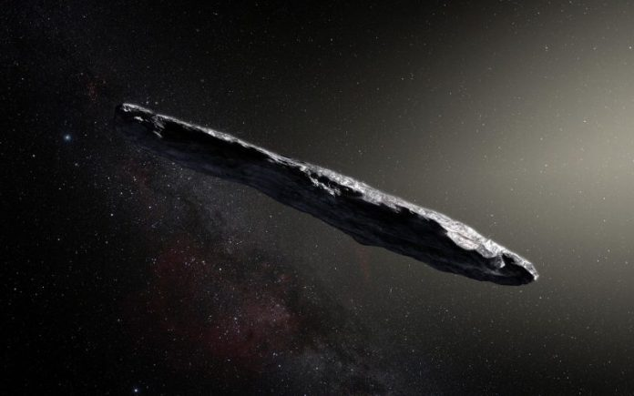 Long rocky asteroid-like object against background of stars and Milky Way.