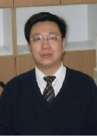 An old Chinese man with glasses, in a sweater and tie.