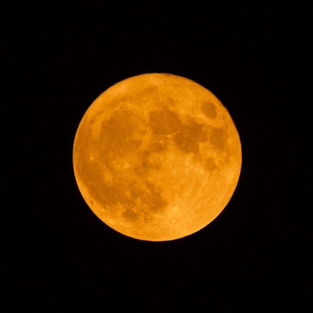 Big orange-yellow full moon.