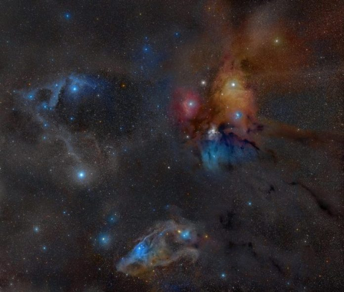 Colorful stars surrounded by dark and light wisps.