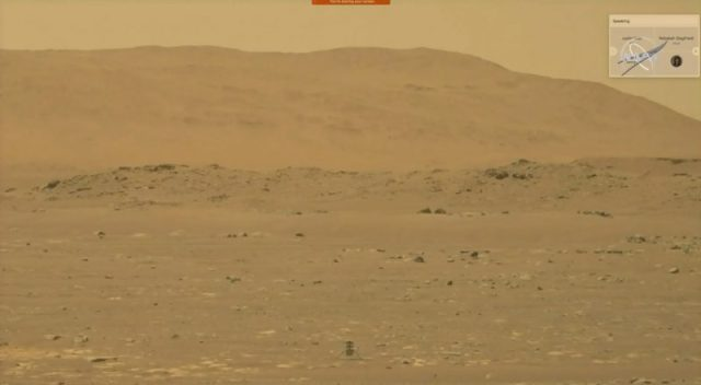 Desolate orange-hued Mars-landscape with a small helicopter bottom center after its first flight.