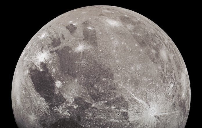 New images of Ganymede, moon-like body with rayed crater and bright and dark patches.