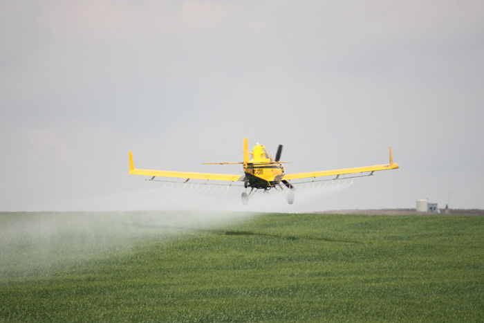 crop duster 700x467 EarthTalk: Questions & Answers About Our Environment