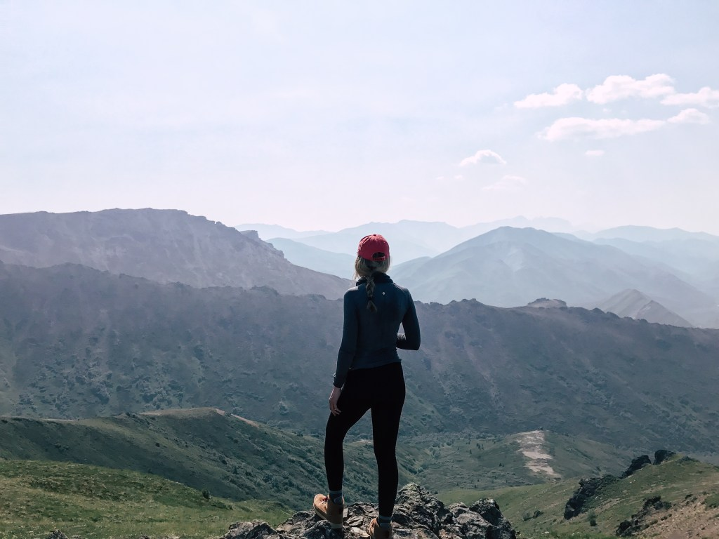 Girl standing looking out while backpacking in Denali national park