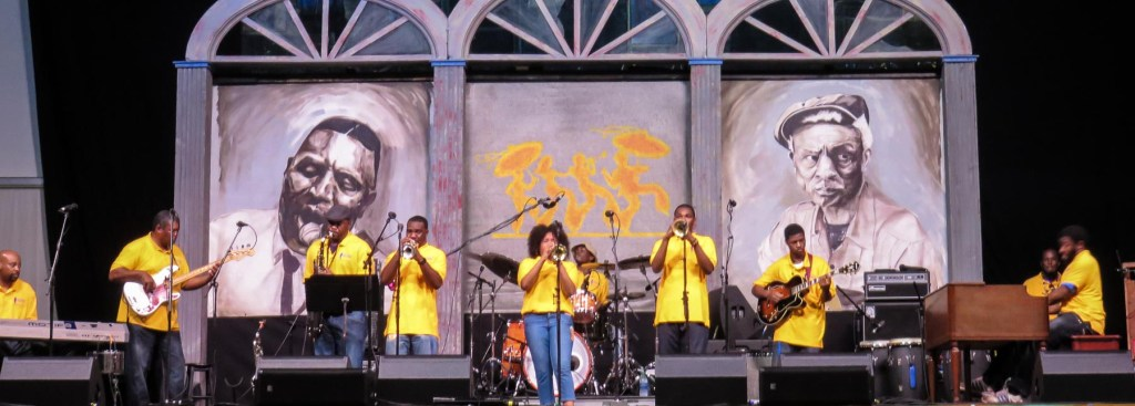 Picture of a band playing in the Blues Tent.