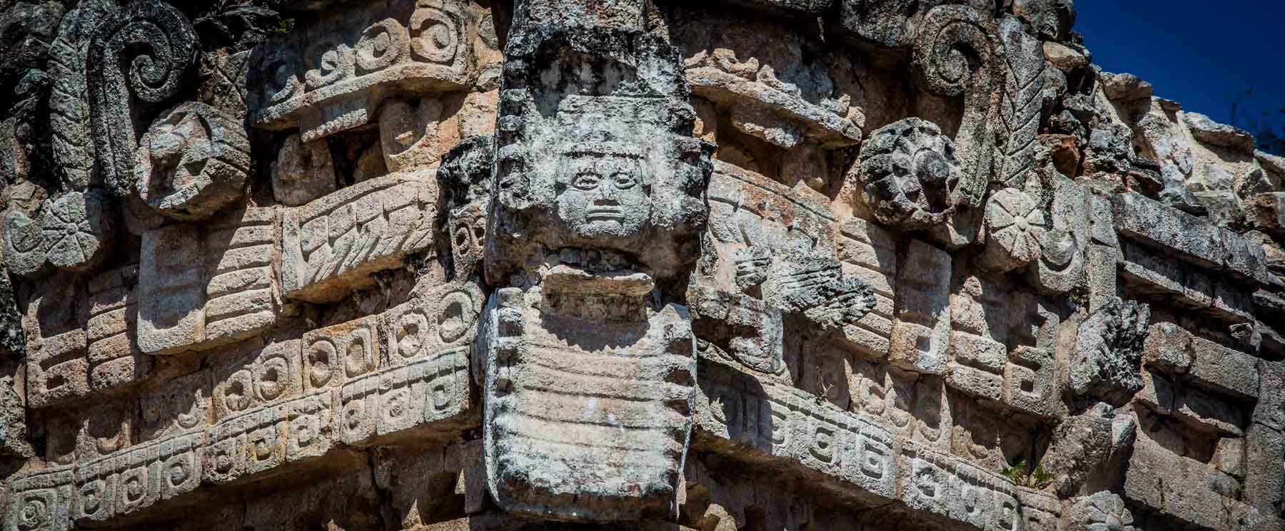A head in a snake's jaws – a popular motif at Uxmal.