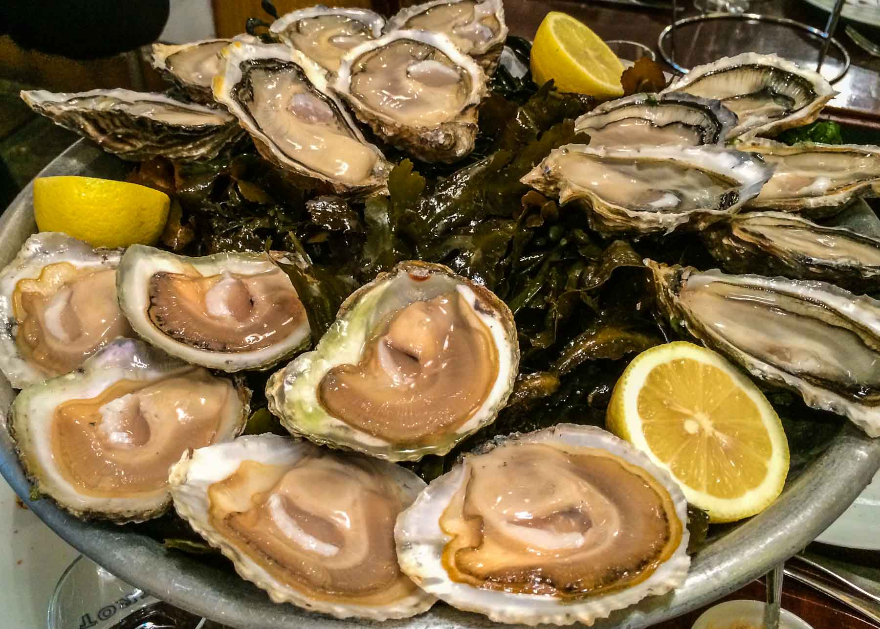Platter of three kinds of oysters.