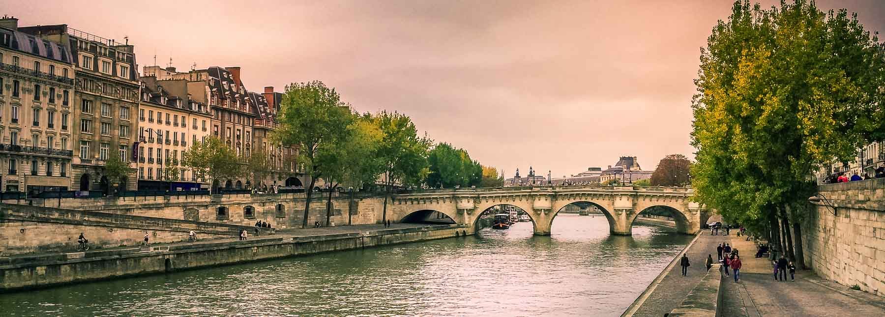 The Seine at dusk with bridge.
