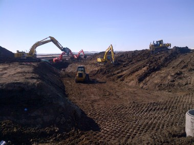 M.A.P. Excavators & Cats Digging Trenches