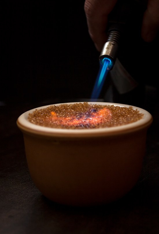 Caramelizing crème brûlée