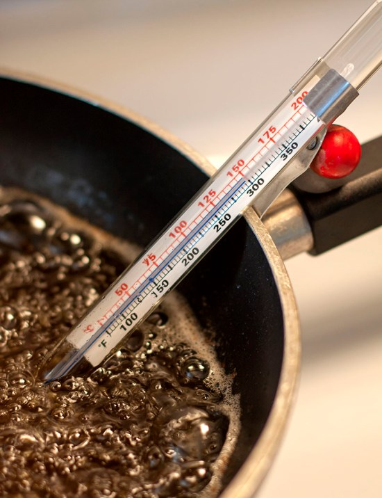 Bubbling oil with thermometer