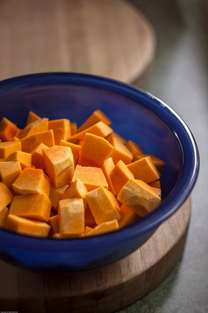 Chopped butternut squash in blue bowl