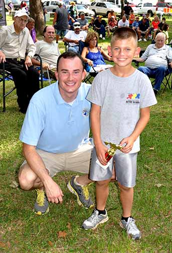 Most Fish boys ages 8-10 Kaeden Jones pictured with Councilman Chris Loar.  Photo by Teri Henry