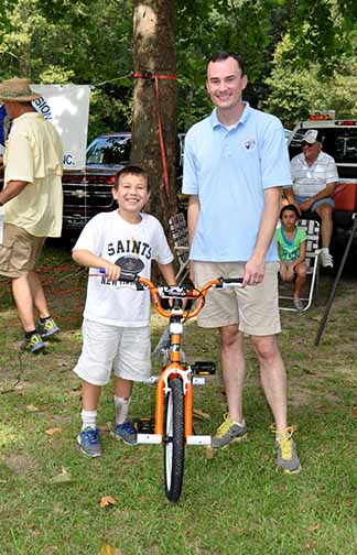 Bicycle Winner boys ages 5-14 Braden Stone pictured with Councilman Chris Loar.  Photo by Teri Henry
