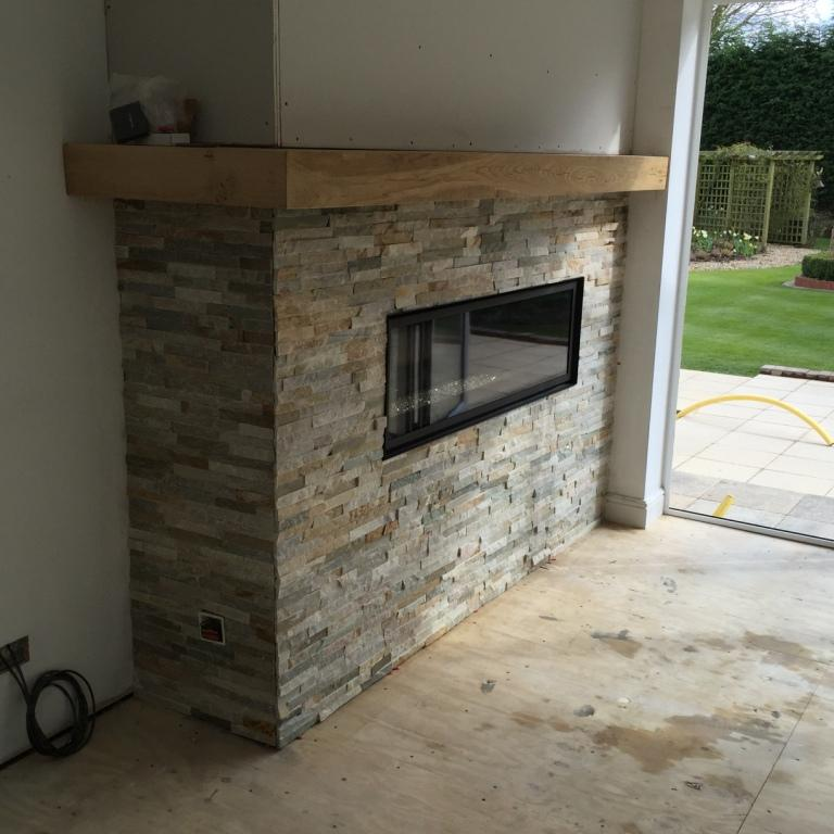 tiling a fireplace in oyster slate