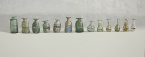 A row of Roman bottles by Lillias August