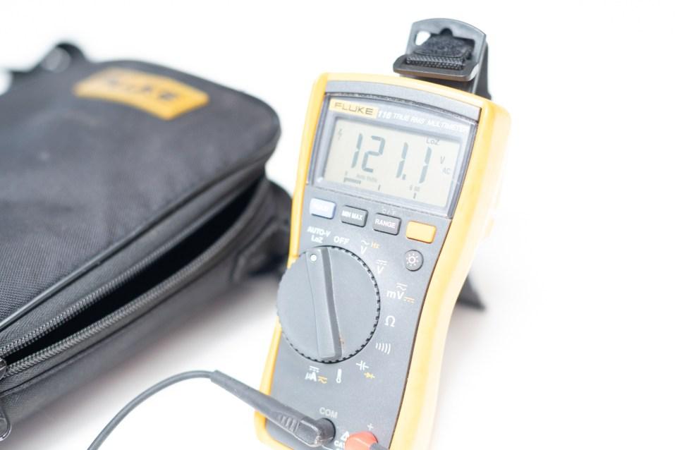 fluke brand digital multi-meter reading 120VAC