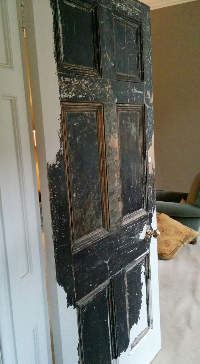 Living room door, half stripped