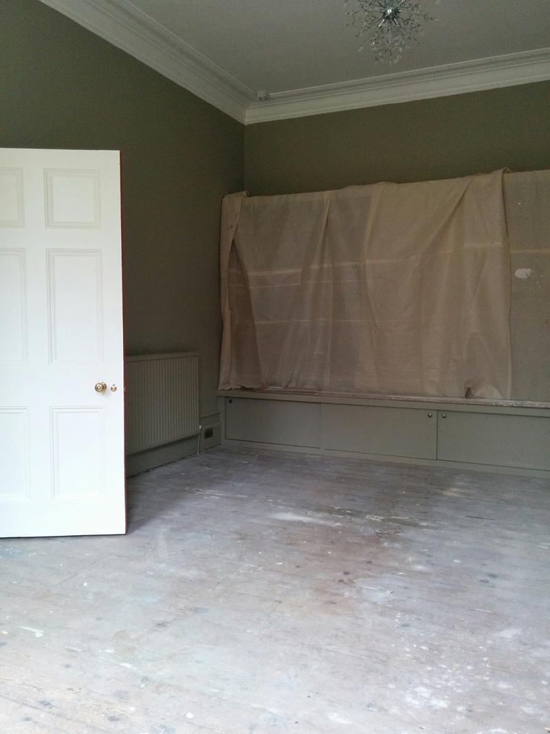 Living room floor before sanding