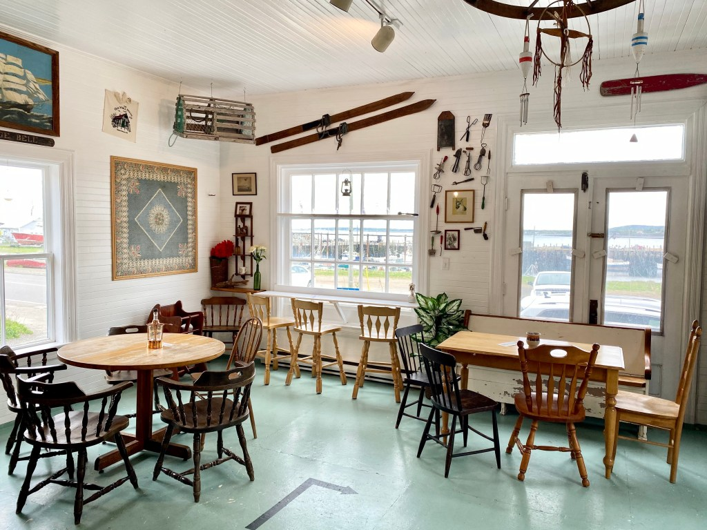 Lovely atmosphere of Old Well House Cafe near the ferry landing with a handful of tables and chairs where Crystal Richard gets her latte's on Grand Manan.