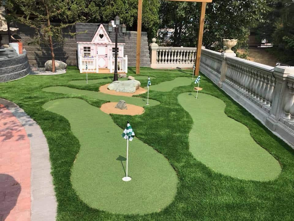 15 Backyard Putting Greens That Will Make You Jealous ... on Putting Green Ideas For Backyard id=94320