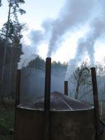 Smoke billows from the charcoal kiln Photo: Matt Parkins