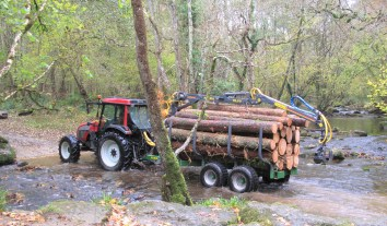 Tractor crossing the River Bovey.