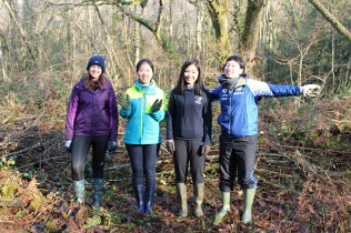 Lesya, Grace, Claire and Tomomi cleared a space for the soil tip