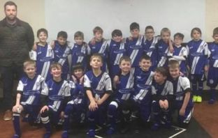 The young Ottery side, coached by Louise Snow, and Chris Williams, sport their new kit.