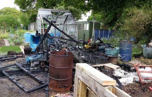 The remains of the arson-hit shed at allotments in Hamilton Lane, Exmouth. Picture: Devon and Cornwall Police.
