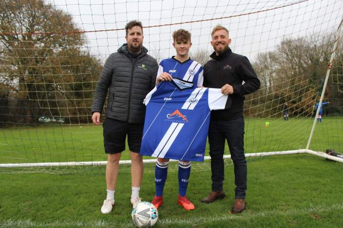 Ottery St Mary AFC U15s Man of the Match Jack Carpenter with team boss Addy Carpenter (left) and kit sponsor Gary Yelland, of Artisan Roofing. Picture: STEPHEN UPSHER