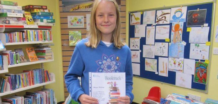 Budleigh Library celebrates Megan's 'marvellous achievement', reading 100 books
