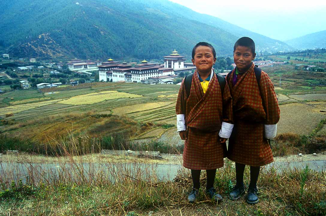 Smiling children & Royal Palace, Thimphu, Bhutan