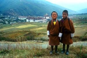 Smiling children & Royal Palace, Thimphu, Bhutan