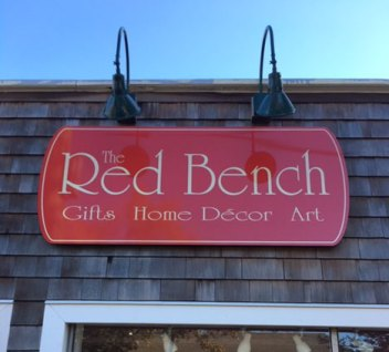 Red Bench carved storefront sign