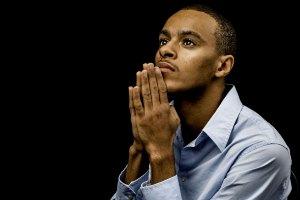 Young African American Man Praying