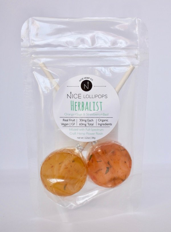 Herbalist hemp CBD lollipops feature Orange + Sage and Strawberry + Basil flavors. 30mg CBD per Lollipop, 60mg CBD total. Vegan, Gluten Free.