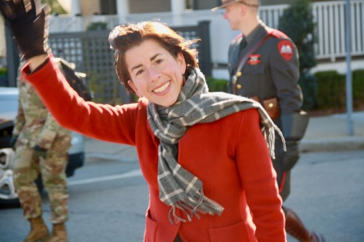 Governor Gina Raimondo waves to spectators on Main Street during the 2017 Veterans Day Parade.