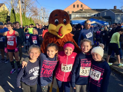 Born to run, 10-year-old edition: Friends Catherine Sprague, Vivian Stone, Kate Foster, Olivia Prior, and Maeve Kiernan pose with Trotter the Turkey before the 5K.