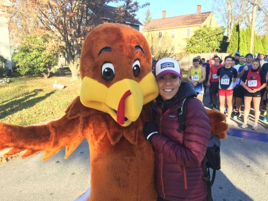 Race organizer Amy Moore with mascot Trotter the Turkey.