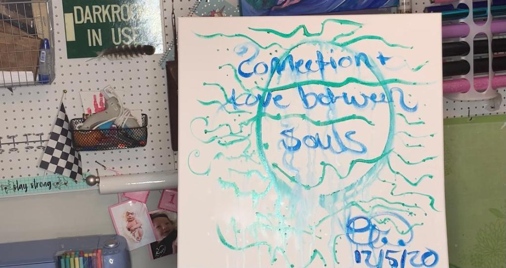 """connection and love between souls"" written under the paint"